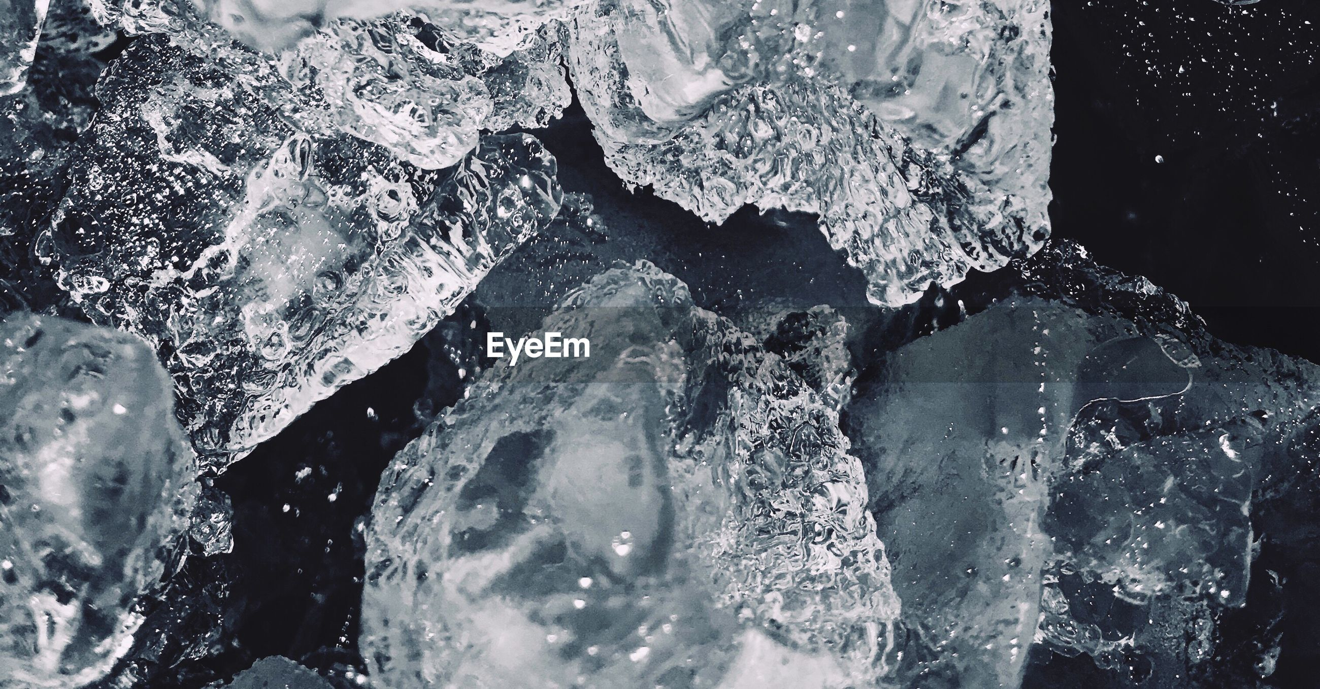 Close-up of ice melting in sea