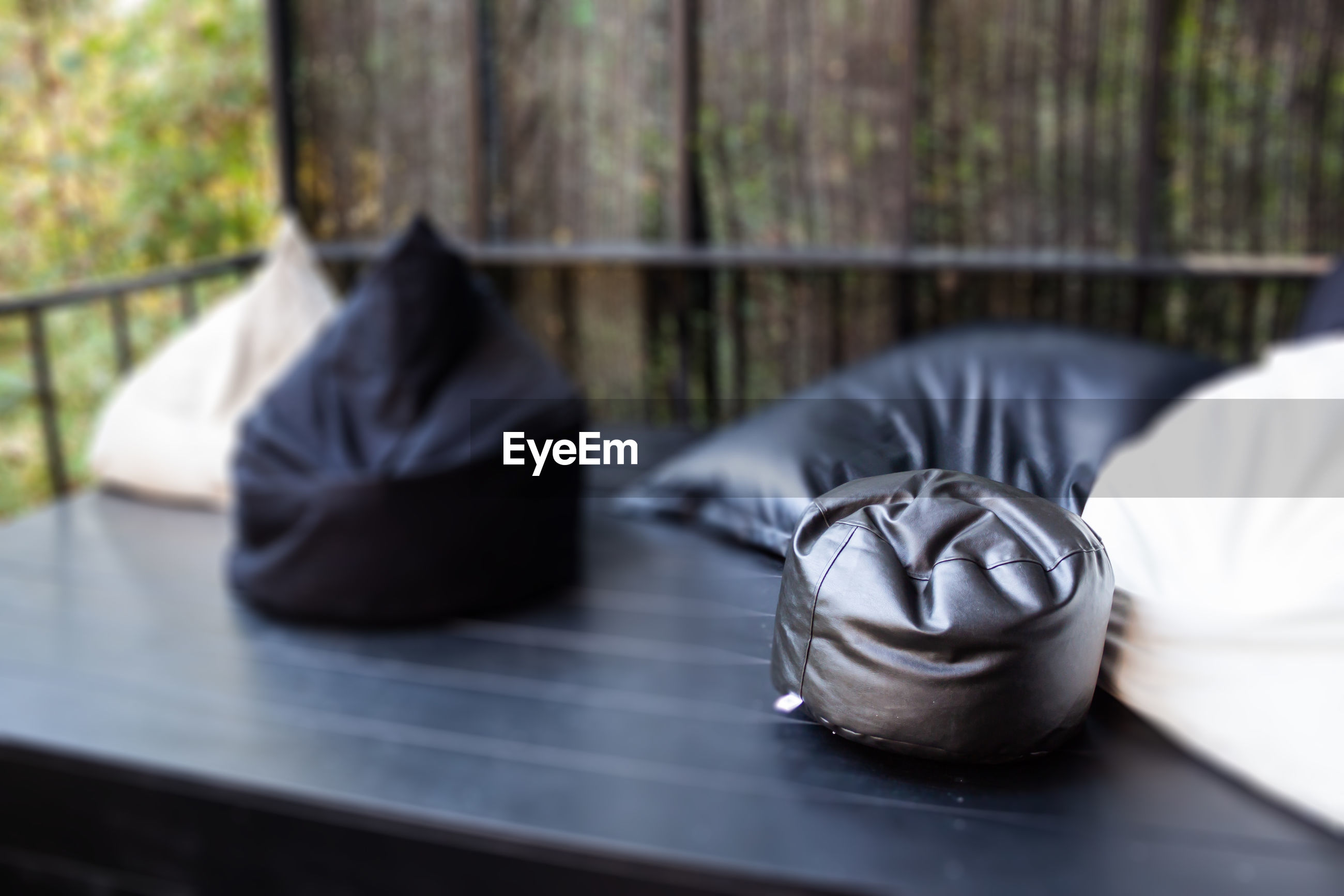 CLOSE-UP OF BLACK COFFEE ON TABLE BY RAILING