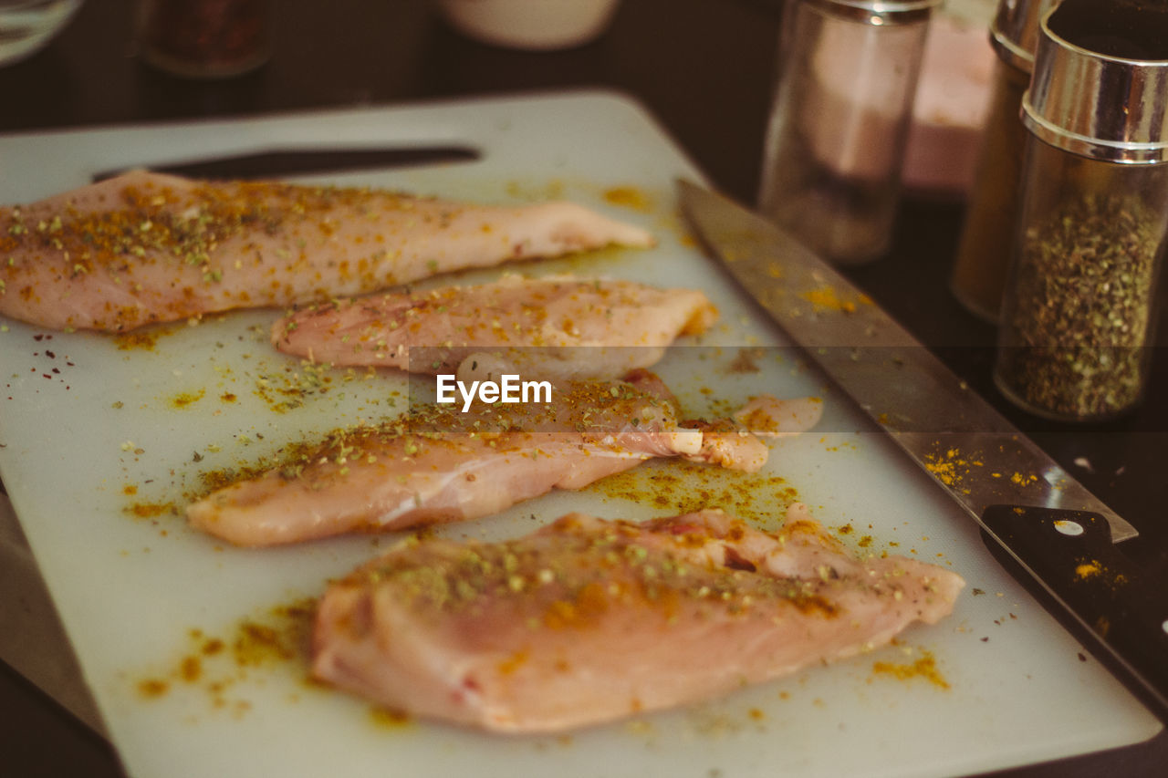 Chicken meat in tray on table