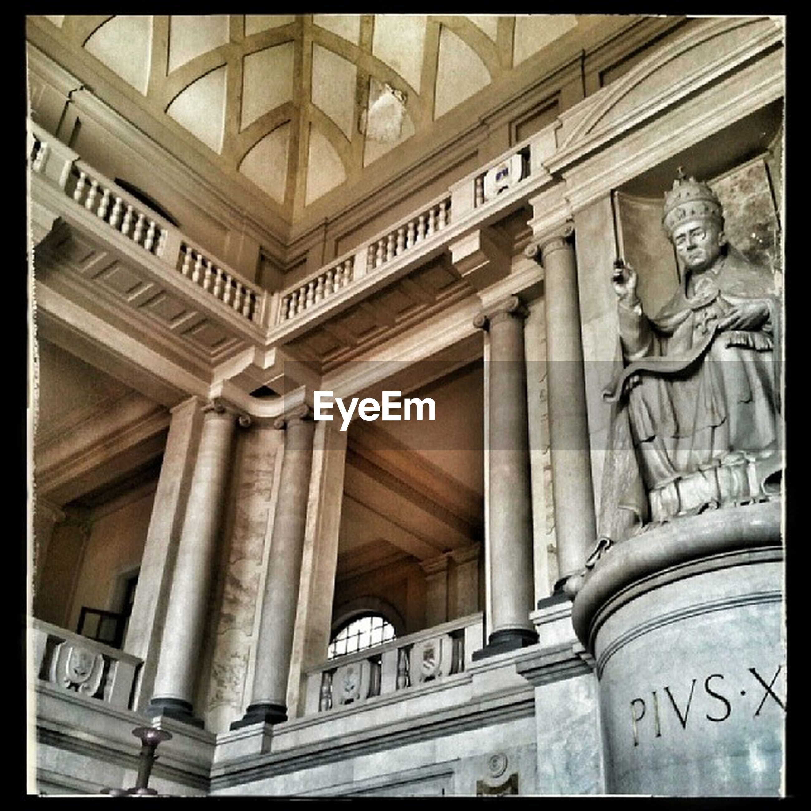architecture, built structure, low angle view, art and craft, architectural column, art, column, history, human representation, creativity, ornate, carving - craft product, text, building exterior, indoors, arch, famous place, travel destinations, design