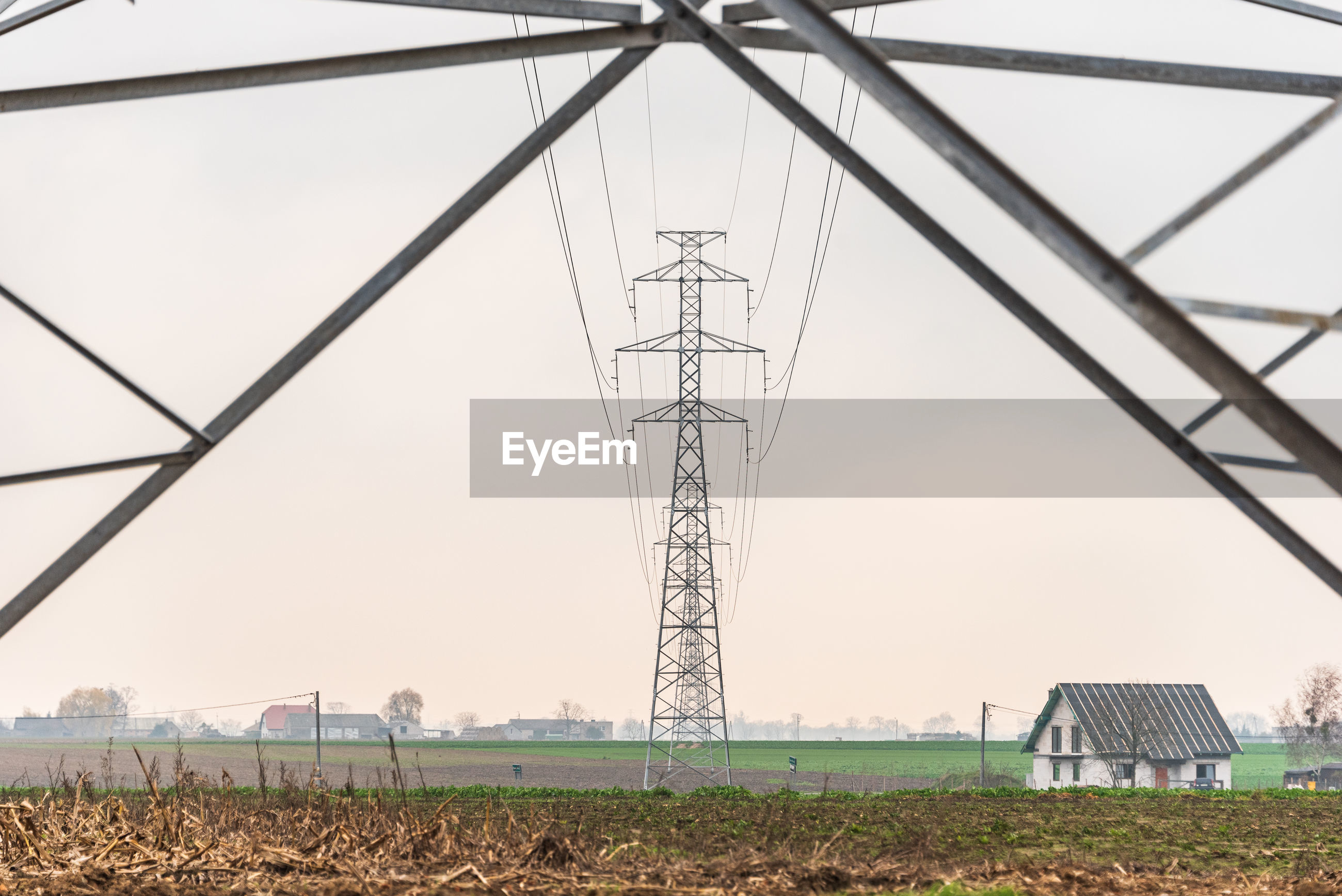 Electricity distribution system. high voltage overhead power line, power pylon, steel lattice tower
