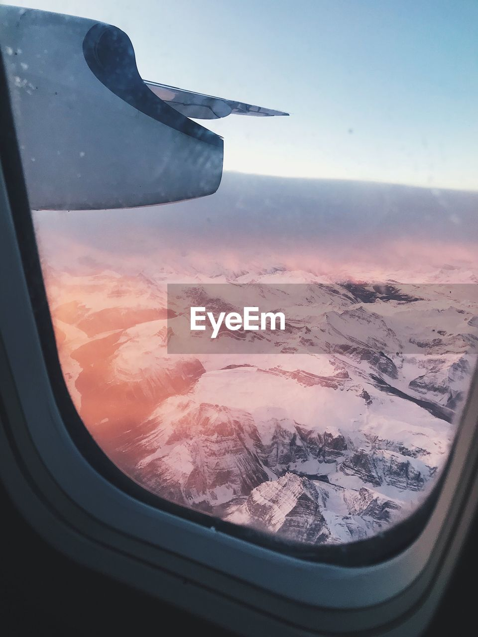 air vehicle, airplane, window, flying, transportation, mode of transportation, scenics - nature, sky, glass - material, beauty in nature, vehicle interior, mid-air, landscape, travel, no people, nature, aircraft wing, environment, transparent, aerial view, outdoors, glass