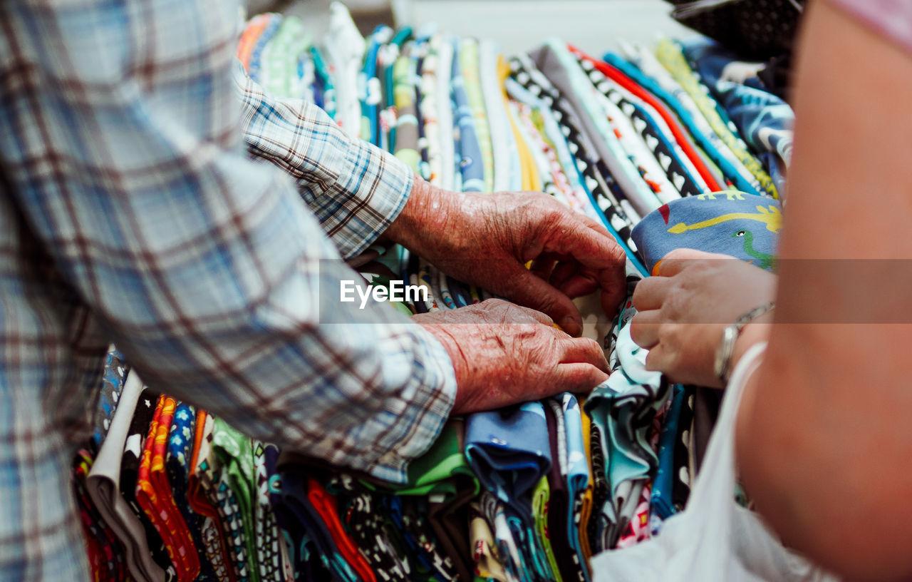 Close-Up Of People Browsing Fabrics