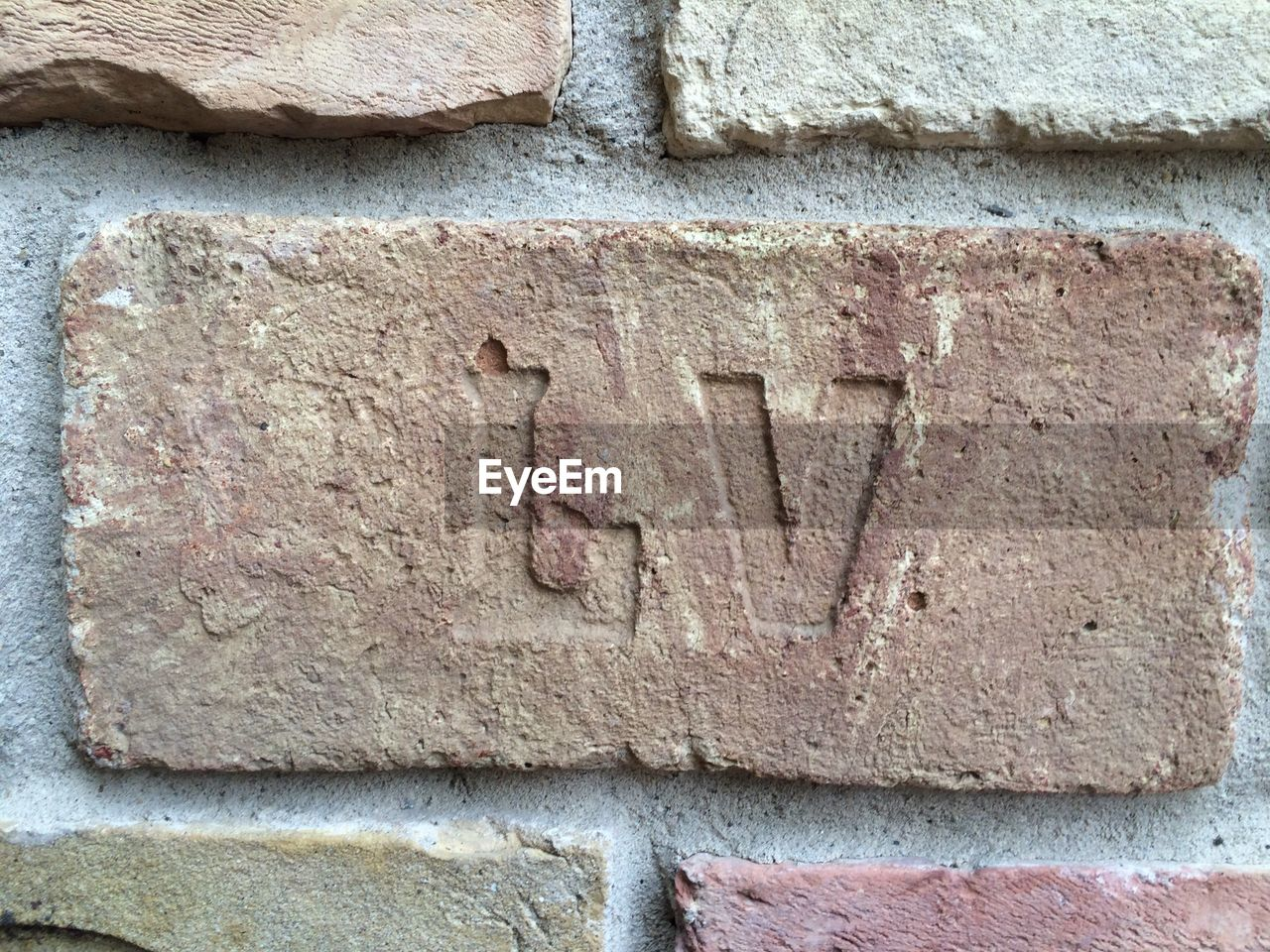 wall - building feature, text, communication, day, architecture, outdoors, brick wall, built structure, close-up, no people, textured, building exterior