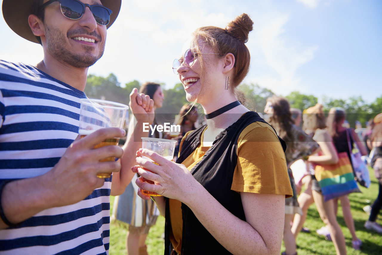 happiness, smiling, emotion, togetherness, drink, enjoyment, young adult, alcohol, real people, event, refreshment, leisure activity, lifestyles, men, young men, celebration, friendship, standing, casual clothing, glass, drinking, positive emotion, outdoors