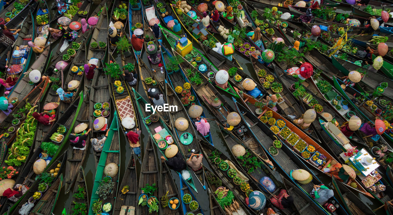 Full Frame Shot Of People Selling Fruits And Vegetables On Boats In River