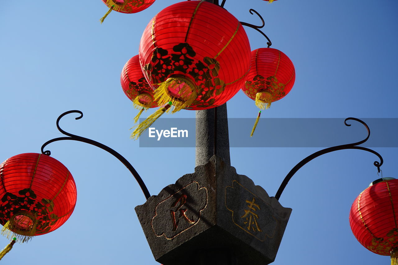 low angle view, red, sky, lighting equipment, celebration, lantern, hanging, decoration, chinese lantern, nature, clear sky, no people, day, traditional festival, outdoors, event, blue, chinese lantern festival, festival, chinese new year, paper lantern