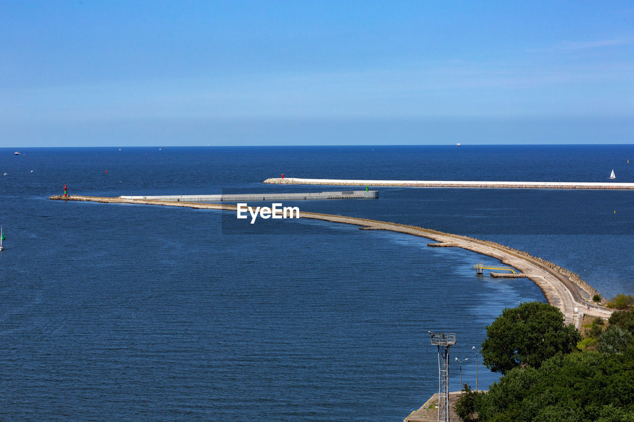water, sea, sky, horizon over water, blue, horizon, transportation, day, nature, no people, scenics - nature, beauty in nature, high angle view, road, outdoors, built structure, bridge, architecture, travel