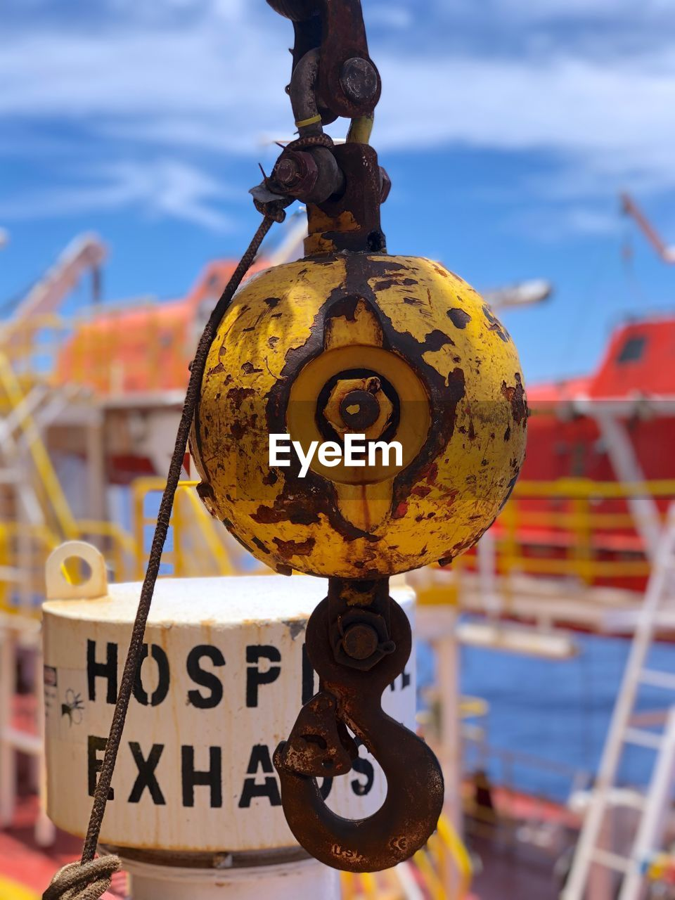 close-up, metal, focus on foreground, no people, hanging, water, day, transportation, communication, text, safety, outdoors, nature, chain, rusty, sky, nautical vessel, protection, security, nautical equipment