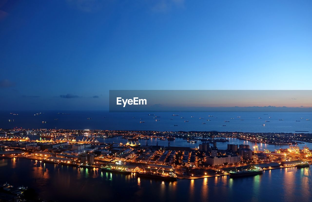 Illuminated Port Of Kaohsiung Against Sky At Dusk