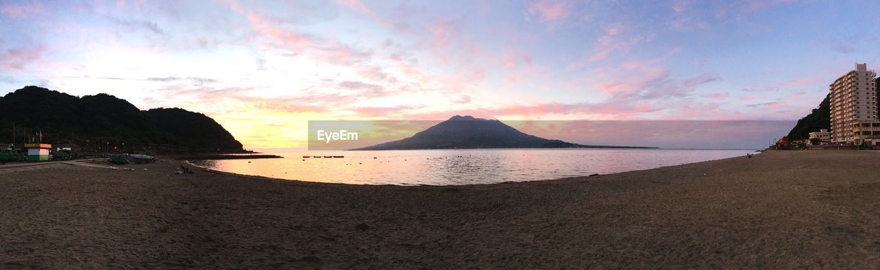 beauty in nature, sky, scenics, nature, sand, tranquility, beach, sea, tranquil scene, water, sunset, outdoors, cloud - sky, no people, mountain, tree, day