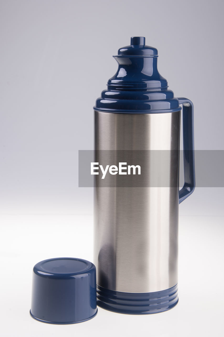 Close-up of insulated drink container against white background