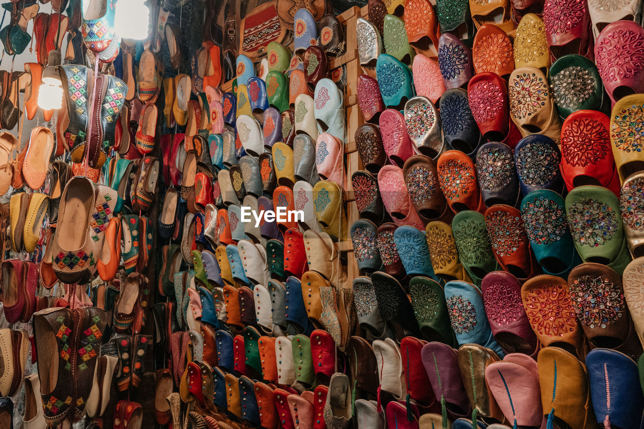 multi colored, large group of objects, abundance, choice, variation, for sale, retail, arrangement, shoe, backgrounds, collection, full frame, order, no people, indoors, in a row, market, still life, retail display, side by side, sale