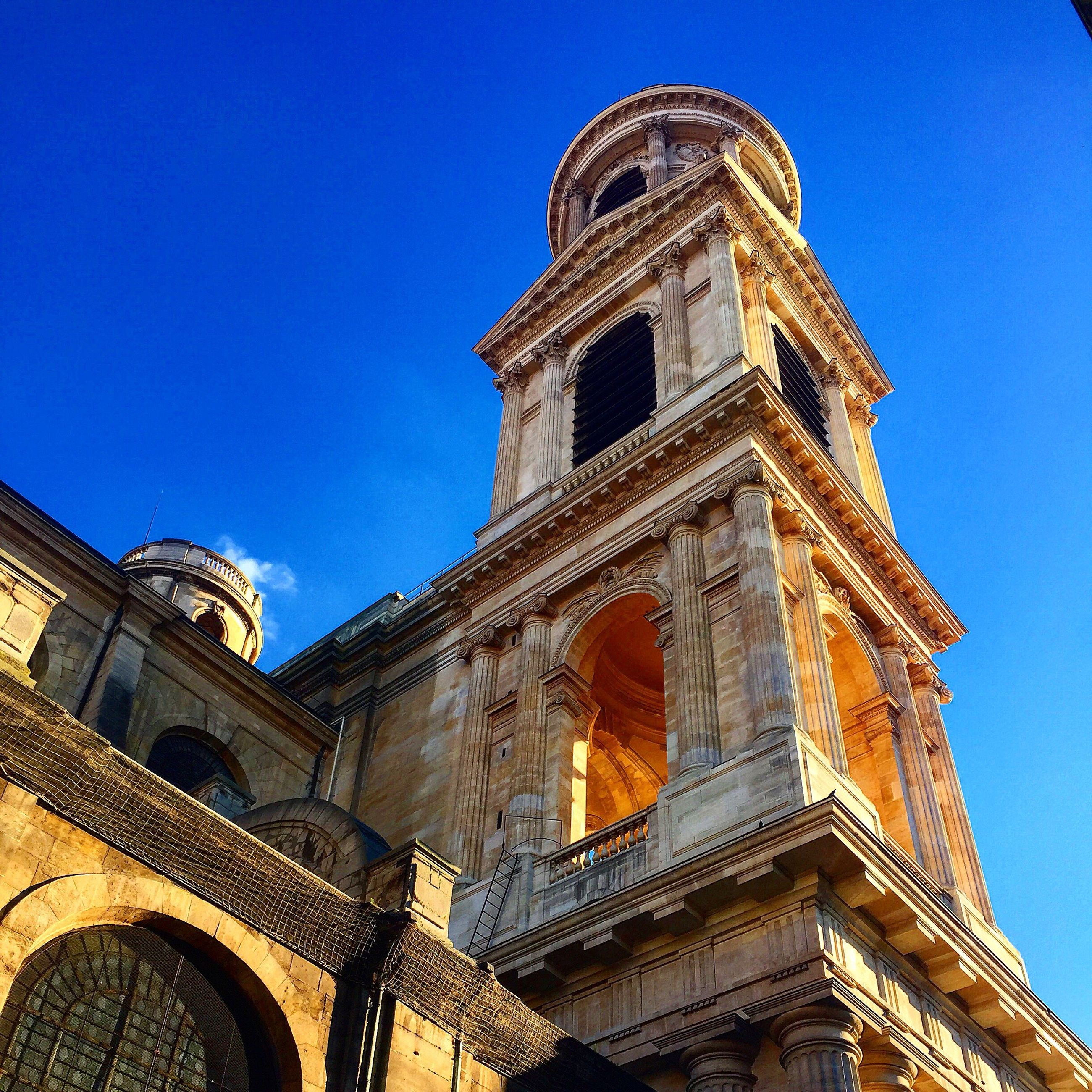architecture, low angle view, building exterior, built structure, blue, clear sky, place of worship, religion, church, tower, high section, tall - high, day, no people, travel destinations, outdoors, sky, tourism