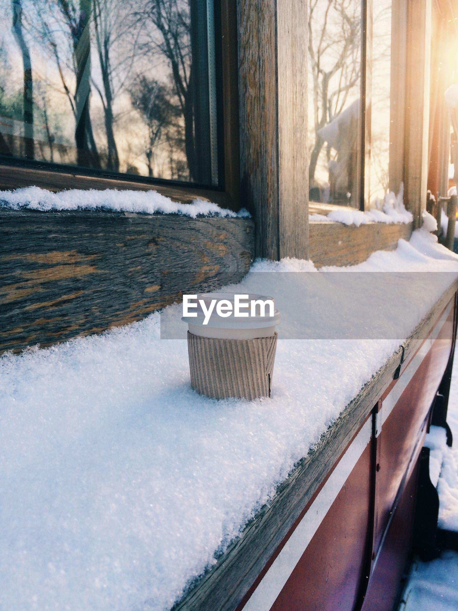 Close-up of snow on window sill