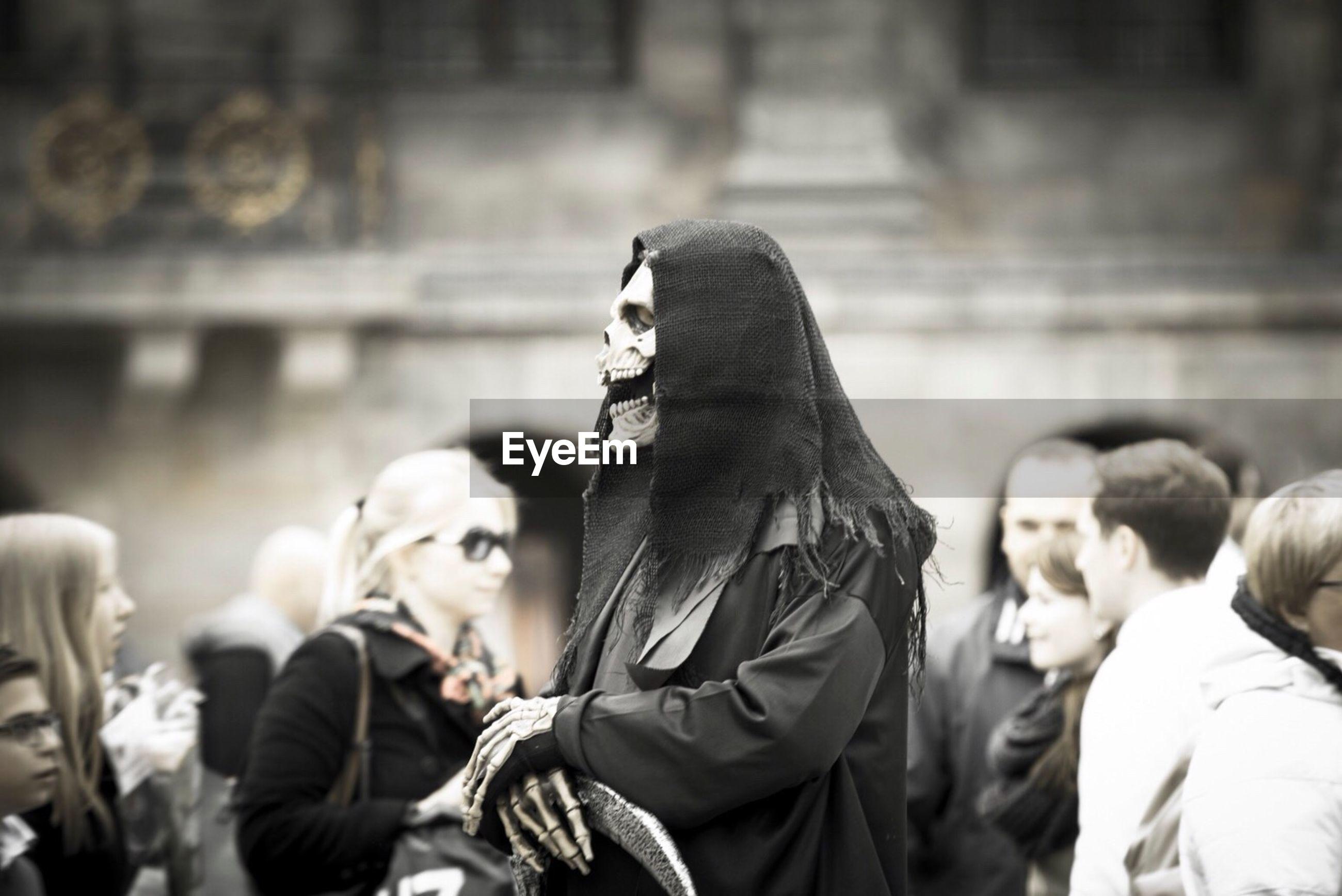 Street performer wearing devil mask