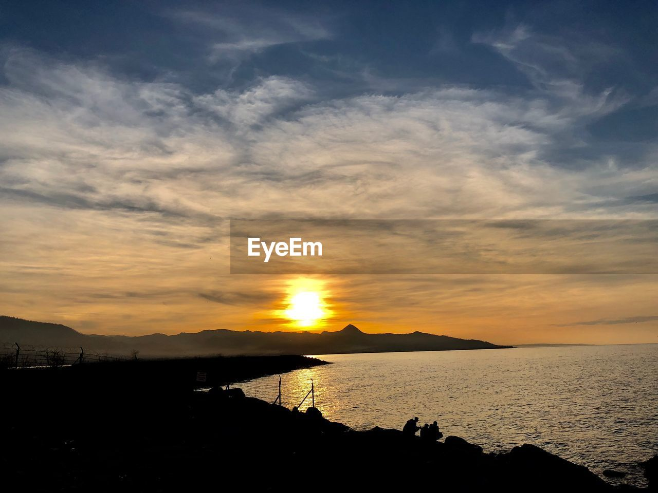sunset, scenics, sky, sea, silhouette, sun, beauty in nature, tranquility, nature, tranquil scene, water, cloud - sky, outdoors, mountain, no people, sunlight, horizon over water, day
