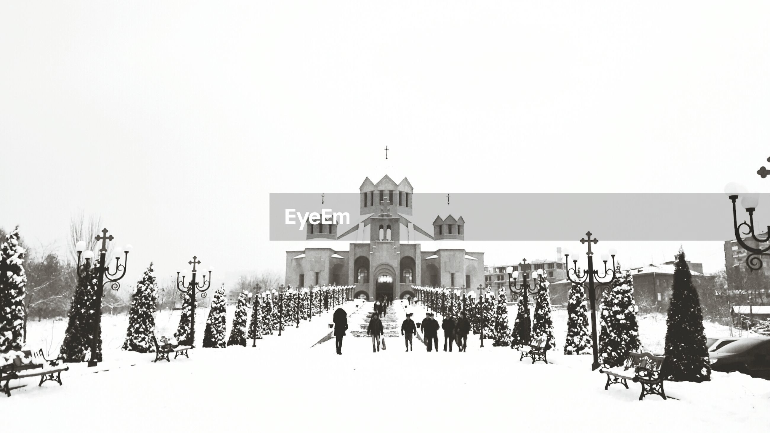 clear sky, architecture, built structure, winter, building exterior, cold temperature, snow, copy space, large group of people, men, person, lifestyles, religion, place of worship, season, walking, church, spirituality