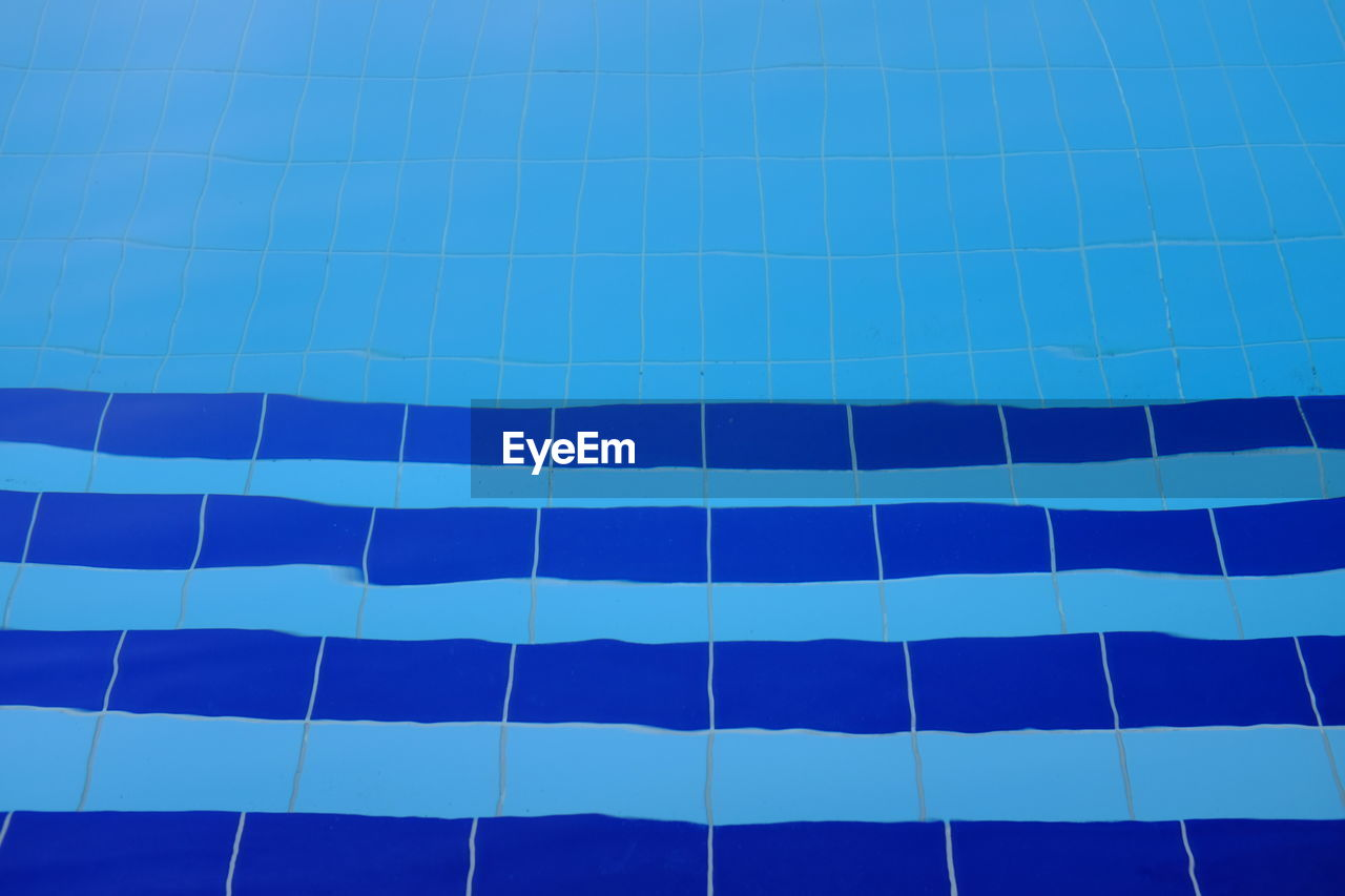 full frame, blue, no people, pattern, day, backgrounds, low angle view, nature, architecture, sky, built structure, outdoors, building, modern, striped, office building exterior, building exterior, repetition, clear sky, swimming pool, skyscraper