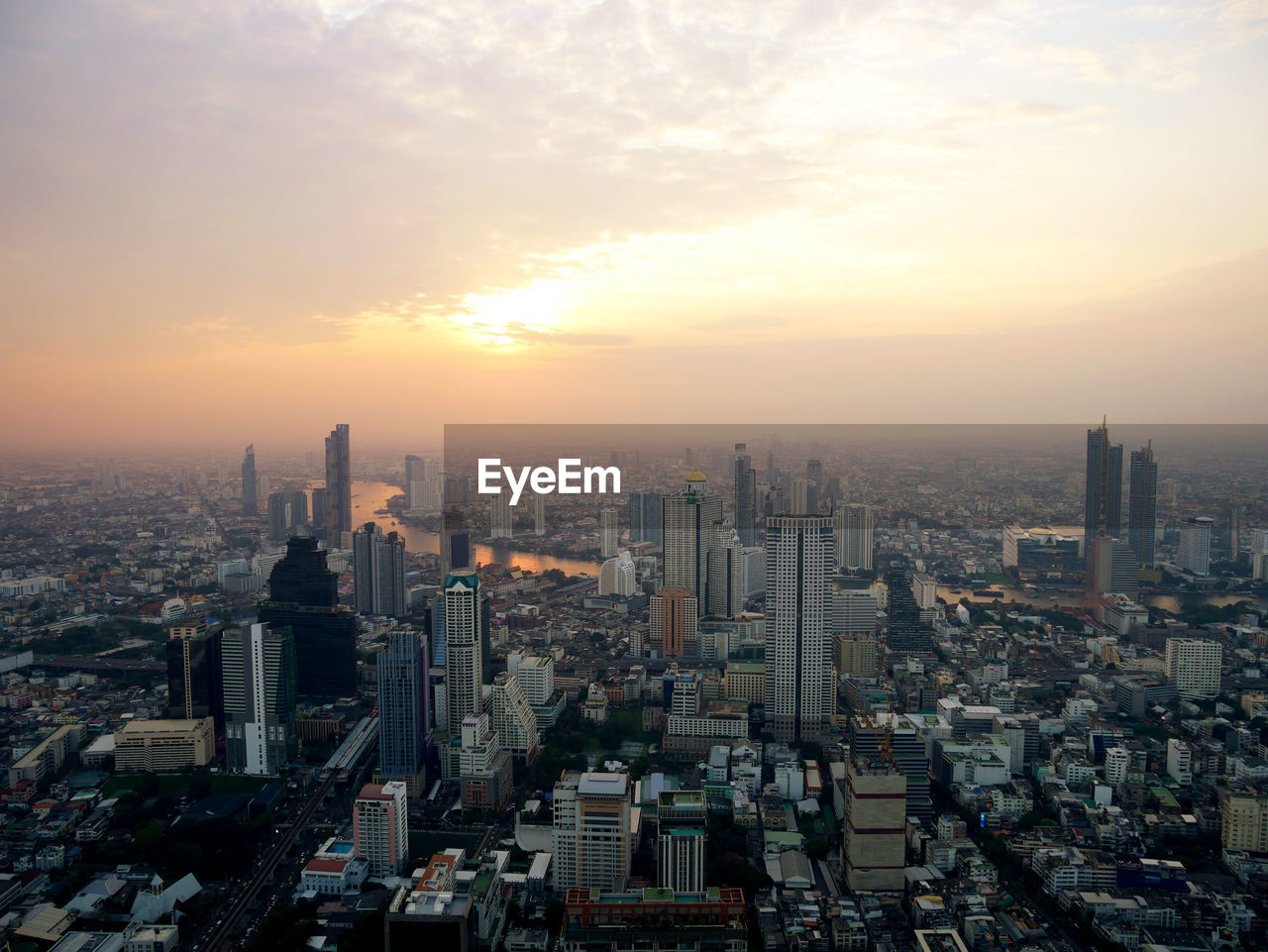building exterior, sky, cityscape, architecture, built structure, city, building, sunset, office building exterior, crowd, skyscraper, tall - high, residential district, crowded, nature, tower, urban skyline, landscape, modern, outdoors, financial district, spire