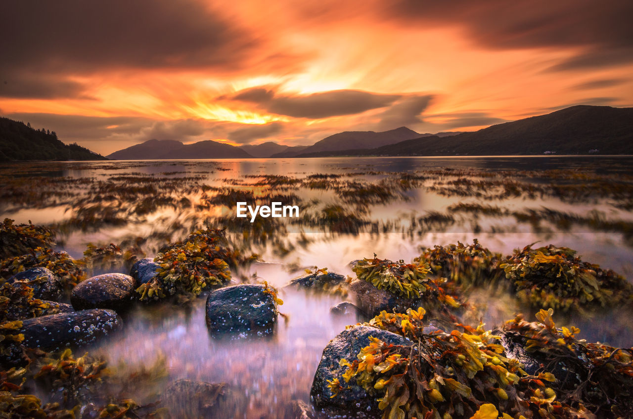 Sunset on a lake in the scottish highlands