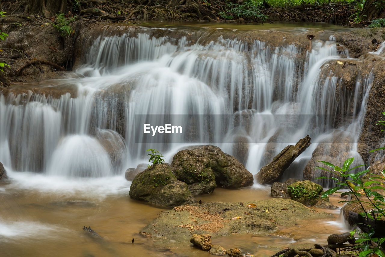 waterfall, scenics - nature, motion, water, beauty in nature, flowing water, long exposure, blurred motion, flowing, rock, plant, forest, nature, no people, tree, rock - object, solid, environment, land, outdoors, power in nature, falling water, rainforest, stream - flowing water
