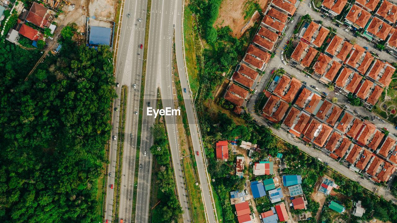Aerial view of highway by residential buildings