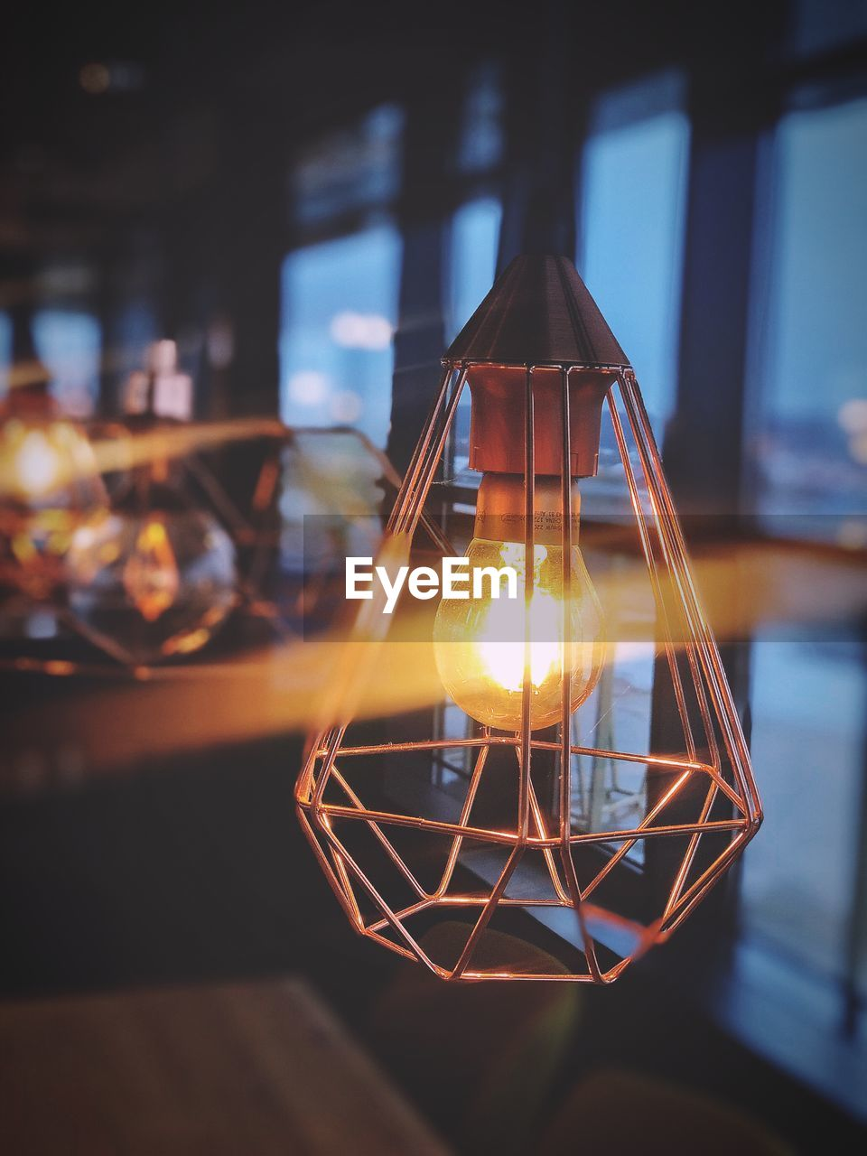 illuminated, focus on foreground, lighting equipment, glowing, indoors, close-up, electricity, no people, electric light, light bulb, light - natural phenomenon, light, glass - material, creativity, transparent, decoration, hanging, technology, design, electric lamp