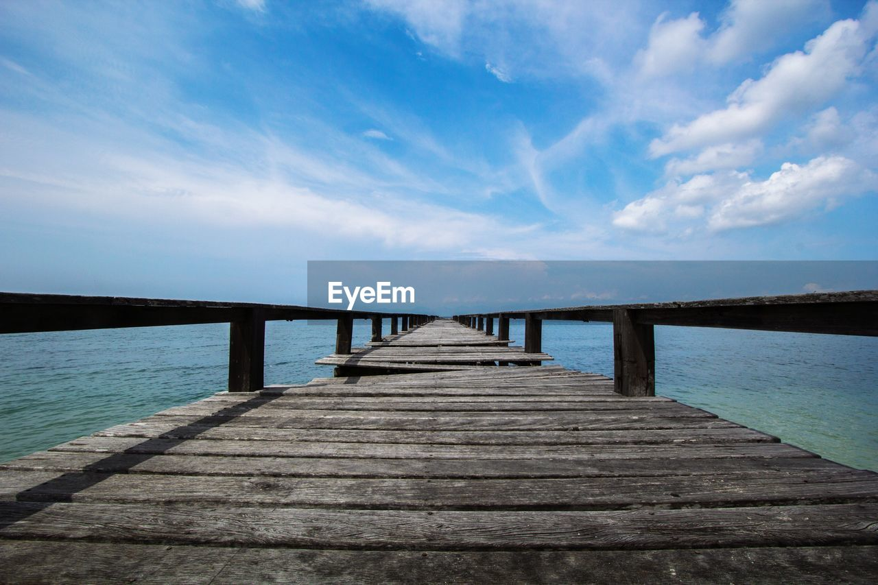 sky, water, cloud - sky, pier, direction, the way forward, wood - material, nature, built structure, tranquility, connection, architecture, jetty, sea, tranquil scene, no people, scenics - nature, blue, bridge, wood, outdoors, diminishing perspective, horizon over water, long, wood paneling, surface level