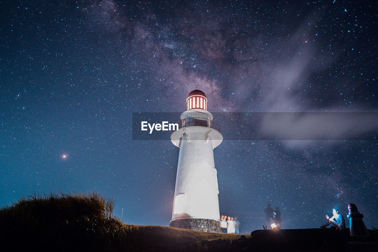 Low Angle View Of Lighthouse Against Star Field At Night