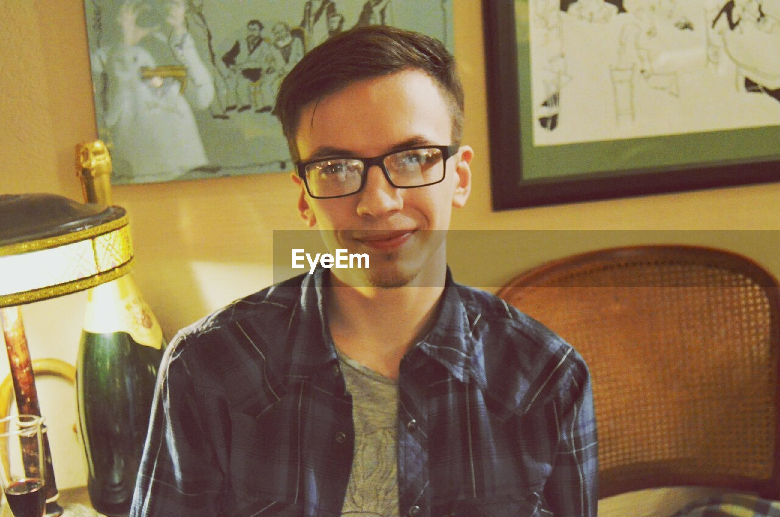 indoors, looking at camera, lifestyles, casual clothing, portrait, person, young adult, front view, young men, waist up, leisure activity, headshot, home interior, eyeglasses, standing, table, restaurant