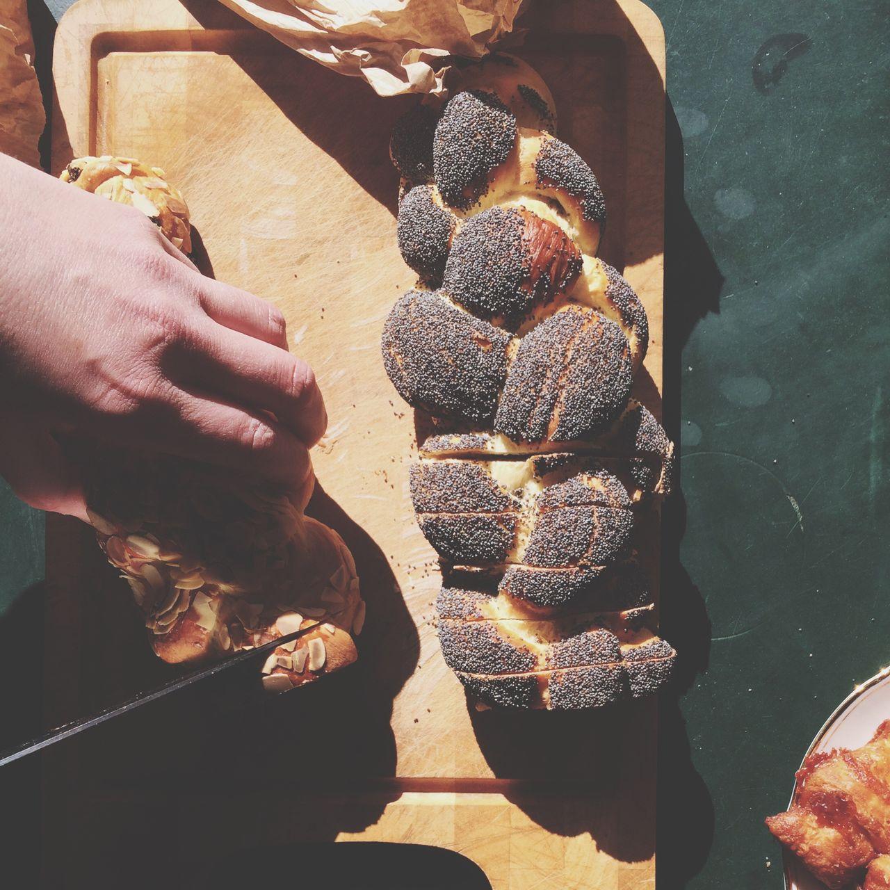 Human Hand Cutting Bread