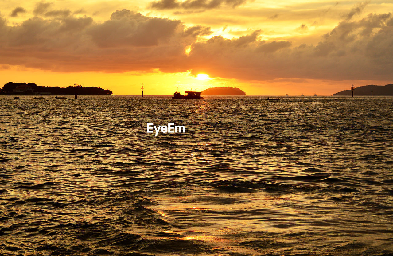sunset, sky, water, orange color, scenics - nature, waterfront, beauty in nature, cloud - sky, sea, tranquility, tranquil scene, nature, idyllic, no people, sunlight, silhouette, outdoors, reflection, non-urban scene