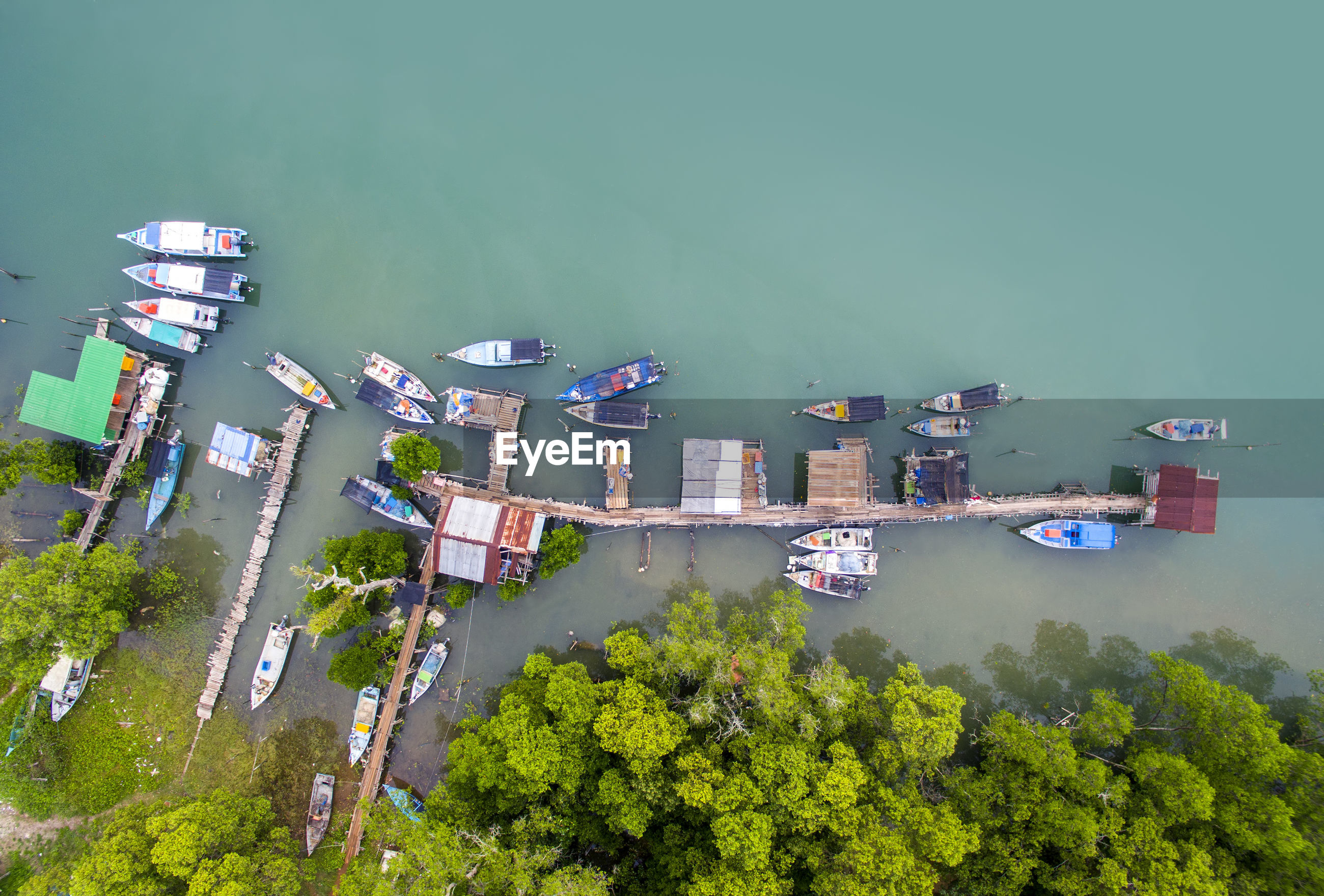 High angle view of boats moored at jetty