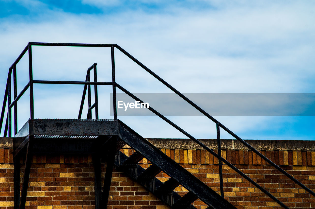 built structure, architecture, sky, cloud - sky, railing, connection, nature, bridge, low angle view, bridge - man made structure, staircase, day, no people, metal, building exterior, steps and staircases, outdoors, transportation, the way forward, travel destinations