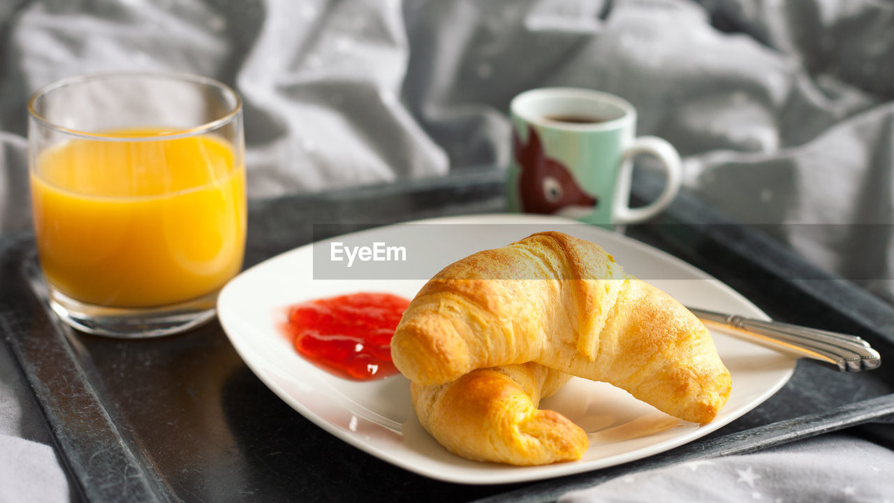 food and drink, drink, food, refreshment, cup, breakfast, table, plate, meal, coffee, mug, ready-to-eat, coffee - drink, still life, freshness, bread, coffee cup, orange juice, baked, household equipment, french food, no people, glass, hot drink, crockery, tray, temptation