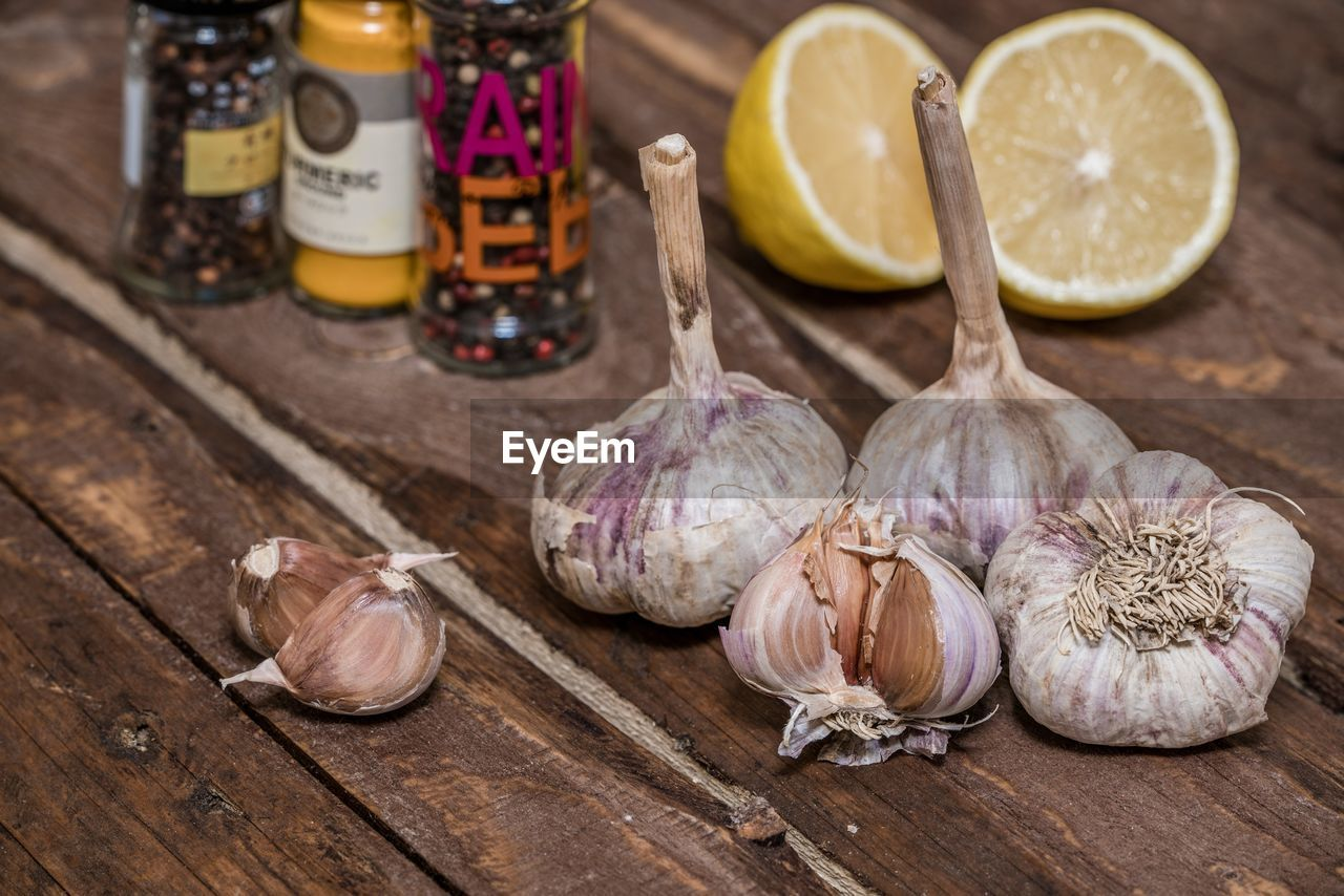 High Angle View Of Spices With Lemon On Wooden Table