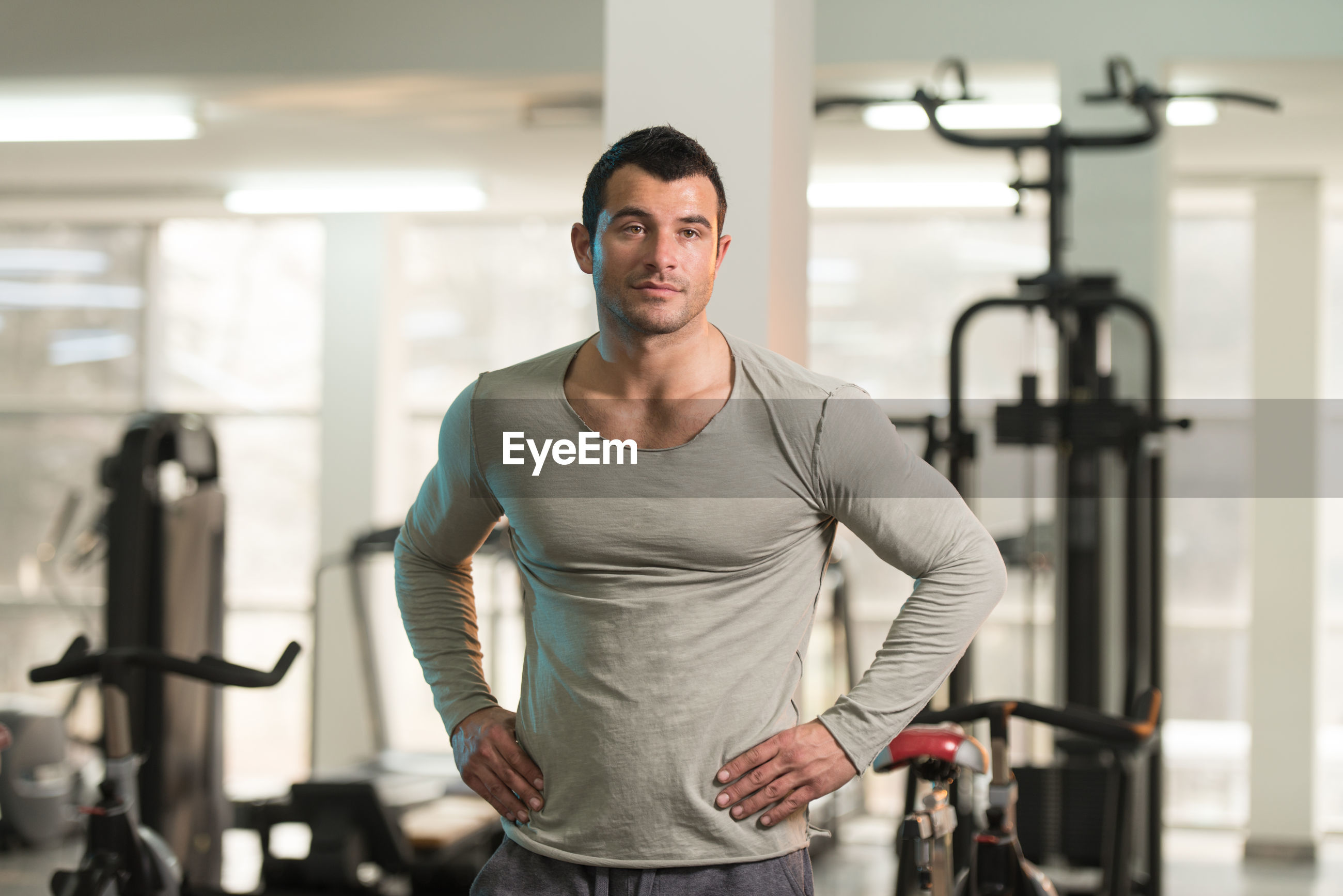 Muscular man standing in gym