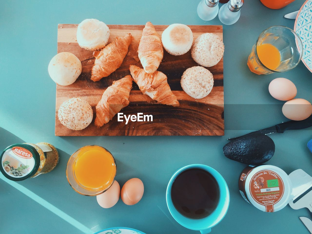 egg, table, food and drink, breakfast, food, bread, plate, indoors, healthy eating, bowl, directly above, cutting board, freshness, no people, drink, egg yolk, toasted bread, eggcup, orange juice, ready-to-eat, day