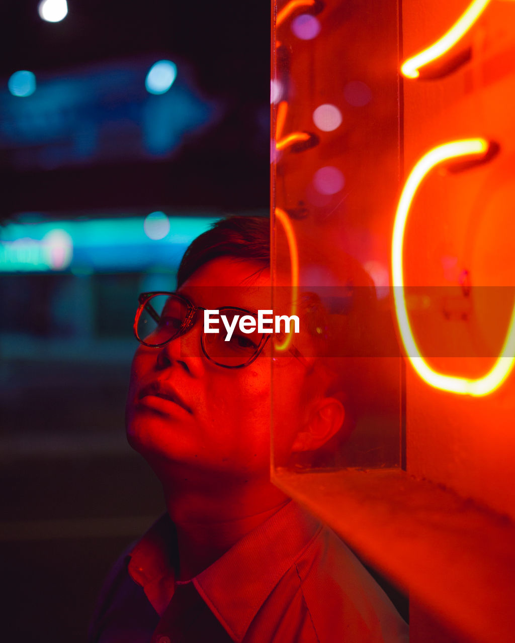 glasses, illuminated, eyeglasses, night, red, headshot, one person, close-up, portrait, glowing, looking, real people, lighting equipment, focus on foreground, men, light - natural phenomenon, neon, outdoors, young men, motion, nightlife, light