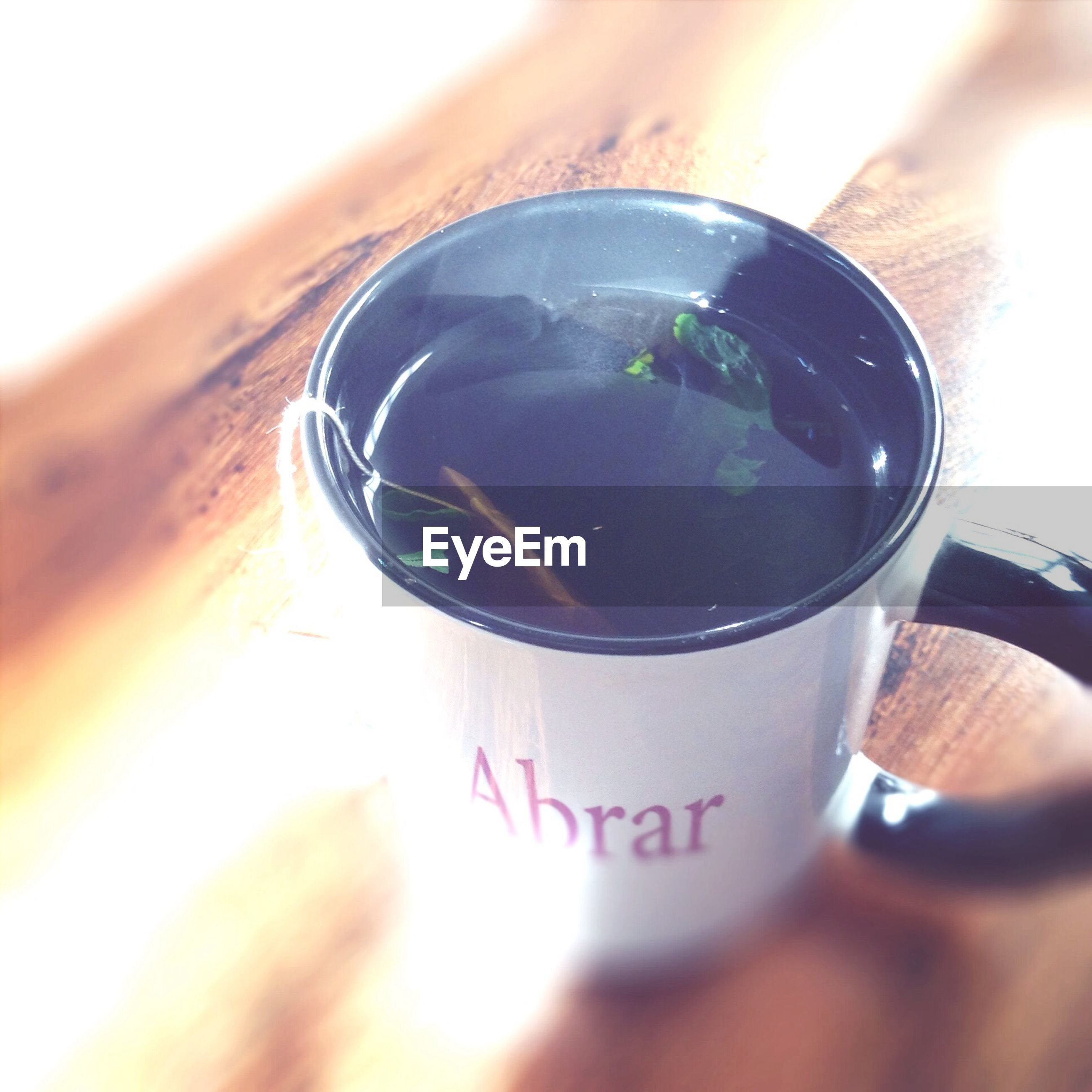 drink, refreshment, person, food and drink, coffee cup, close-up, part of, indoors, holding, cropped, table, coffee - drink, coffee, freshness, unrecognizable person, cup, selective focus