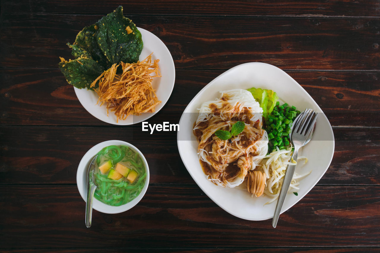 food and drink, table, food, ready-to-eat, freshness, healthy eating, plate, wellbeing, bowl, high angle view, still life, serving size, indoors, meal, directly above, no people, vegetable, wood - material, eating utensil, kitchen utensil, garnish, temptation