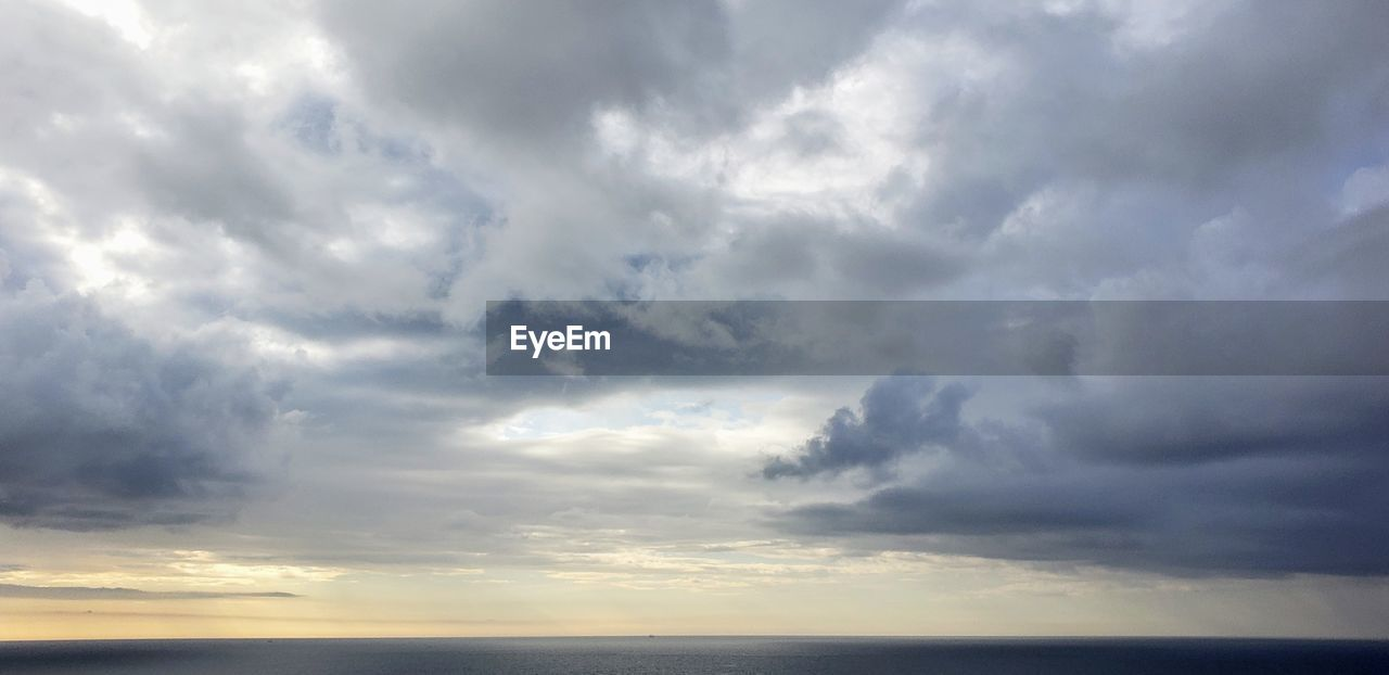sky, cloud - sky, beauty in nature, scenics - nature, horizon, tranquility, sea, horizon over water, tranquil scene, nature, no people, water, storm, overcast, dramatic sky, outdoors, idyllic, environment, ominous