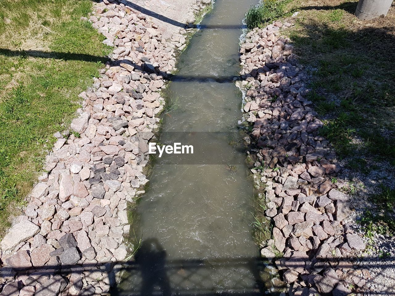 water, day, gutter, high angle view, sewage, outdoors, no people, reflection, sewer, nature, puddle, tree