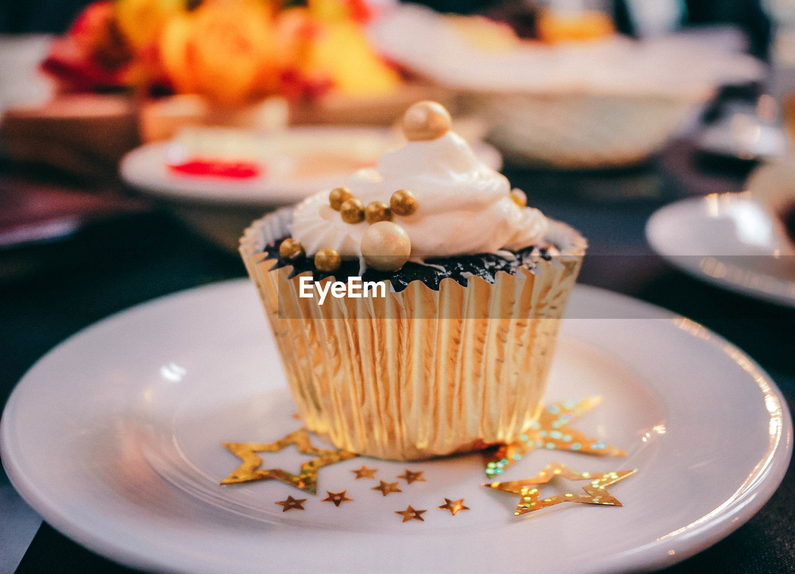 Close-up of cupcake served in plate on table