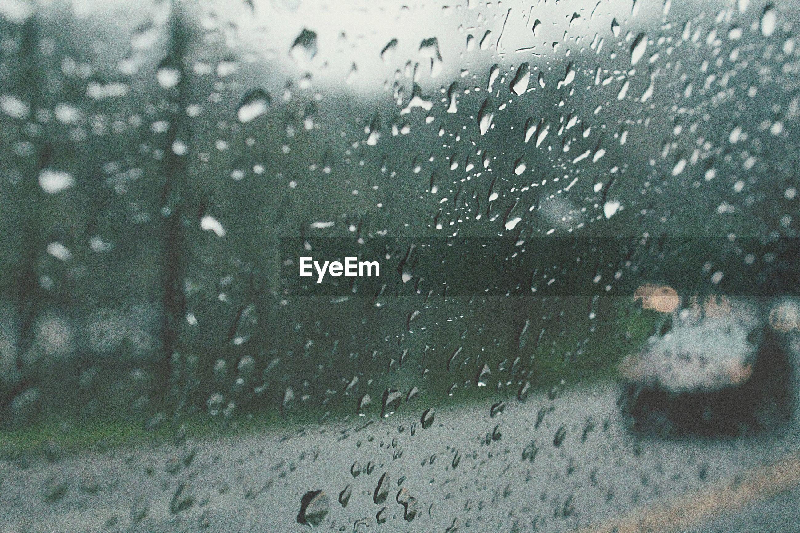 window, transparent, glass - material, wet, drop, rain, water, indoors, transportation, weather, season, car, raindrop, vehicle interior, mode of transport, glass, full frame, land vehicle, backgrounds, monsoon