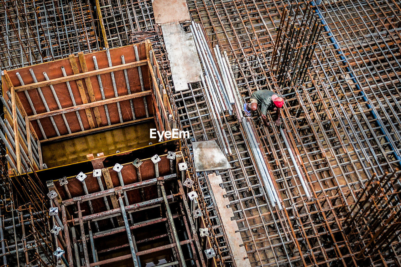 High Angle View Of Worker At Construction Site