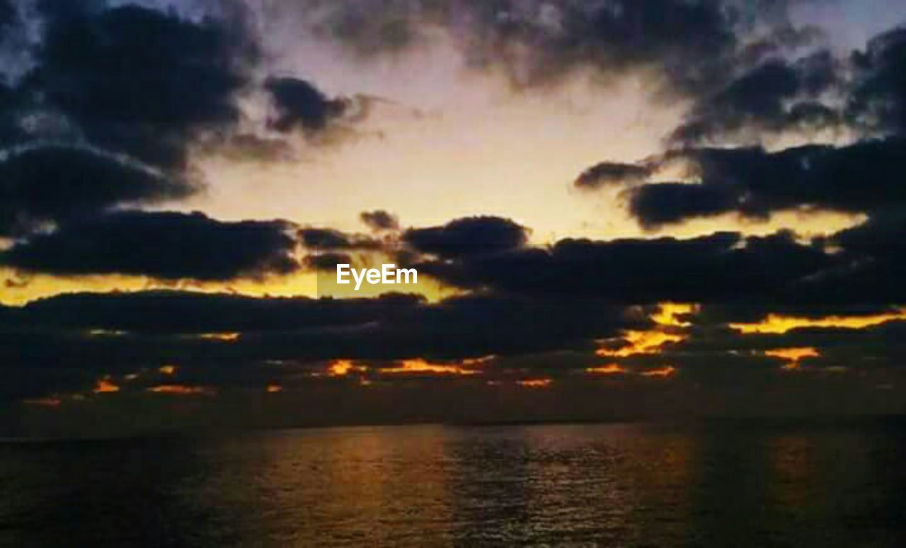 sunset, nature, scenics, tranquil scene, beauty in nature, tranquility, sky, dramatic sky, no people, outdoors, silhouette, cloud - sky, water, sunlight, sea, multi colored