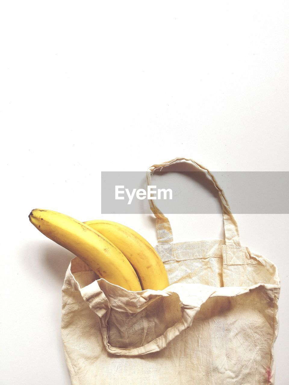 banana, white background, studio shot, healthy eating, indoors, fruit, still life, food, wellbeing, food and drink, copy space, yellow, freshness, no people, close-up, banana peel, group of objects, two objects, single object, peel