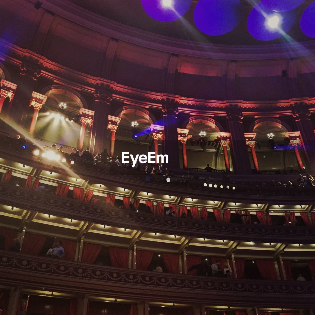 indoors, illuminated, architecture, low angle view, built structure, arts culture and entertainment, music, nightlife, real people, men, night, nightclub, people